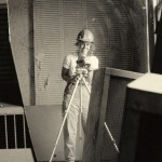 Woman taking a photograph on a construction site